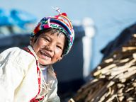 Little kids from reed islands of Uros