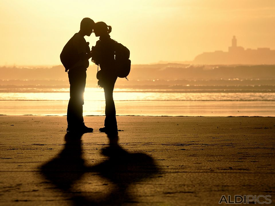 Couple in love on the beach of the Atlantic
